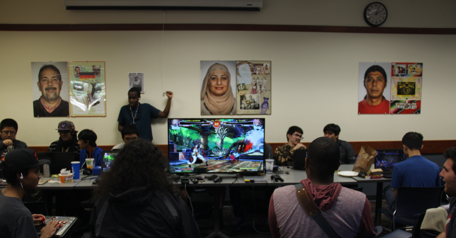 """Students like to play fighting games such as """"Guilty Gear Xrd"""" on a computer monitor in the cafeteria. The games played at the table range from new releases to more retro titles."""