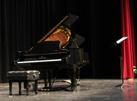 The Black Box Theatre stage was set up for the Guest Artist Series with a grand piano for pianist, Anyssa Neumann and a podium stand for soprano, Rena Harms.