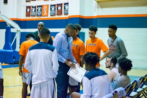 Men's Basketball Coach Jonathan James diagrams a play for his team during a timeout in Jan. 2018. Because of COVID-19, fall sports have officially been pushed back to the spring season.