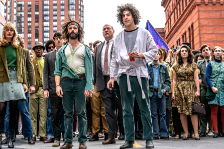 Sacha Baron Cohen and Jeremy Strong as Abbie Hoffman and Jerry Rubin leading protestors through the streets of Chicago.