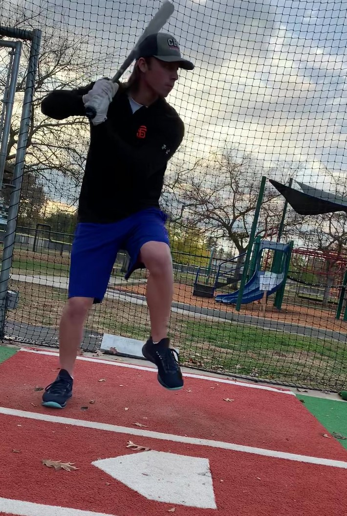 """Keller eyeing a baseball he's about to swing at during some batting practice at Arden Little League on Saturday. Keller hopes to start playing again soon in order to """"release some of the anxiety that [he has] had for the last 7-9 months."""""""