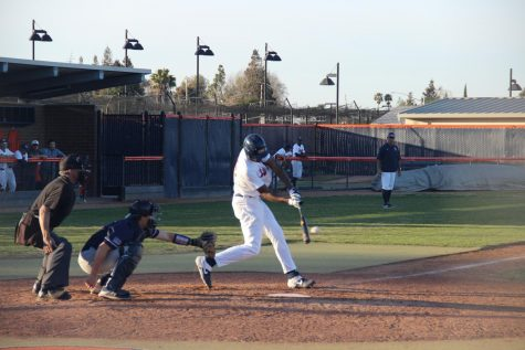Sophomore outfielder Lakeal Morris hitting a ball to right field against the American River College Beavers on Feb. 24, 2020. Spring sports are in the clear to return to practicing and conditioning, and hopefully competition, as long as Sacramento county stays in the red tier.